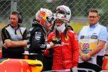 2019年F1第10戦イギリスGP レース後お互いに会話するセバスチャン・ベッテルとマックス・フェルスタッペン